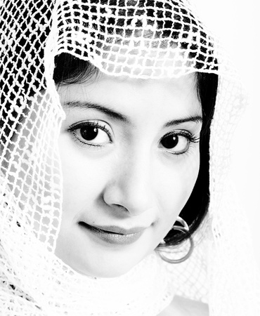 Ethnic Muslim Woman Wearing A  Netted Headscarf photo