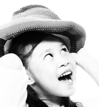Smiling And Happy Girl Putting On A Floppy Hat photo