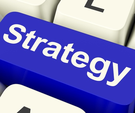 Strategy Computer Key Showing Business Solutions Or Goals