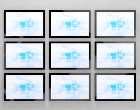 blue widescreen widescreen: TV Monitors Wall Mounted Representing High Definition Television Or HDTVs Stock Photo