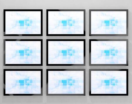 high definition television: TV Monitors Wall Mounted Representing High Definition Television Or HDTVs Stock Photo