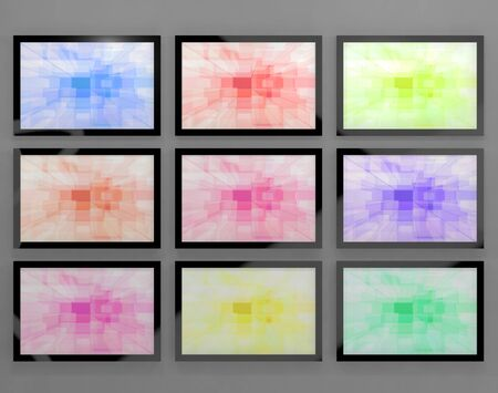hdtv: TV Monitors Wall Mounted In Different Colors Representing High Definition Televisions Or HDTV Stock Photo