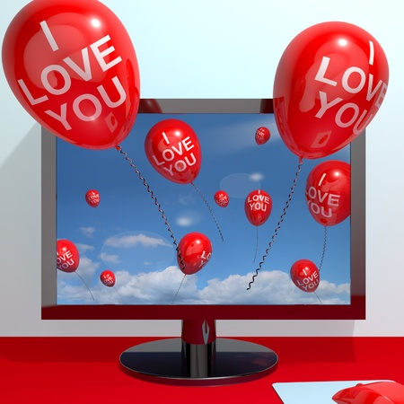 I Love You Balloons Coming From Computer Screen Showing Love And Online Dating Stock Photo - 13481189