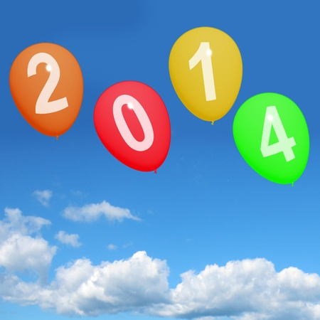 two thousand and fourteen: 2014 Balloons In Sky Represent Year Two Thousand And Fourteen Stock Photo