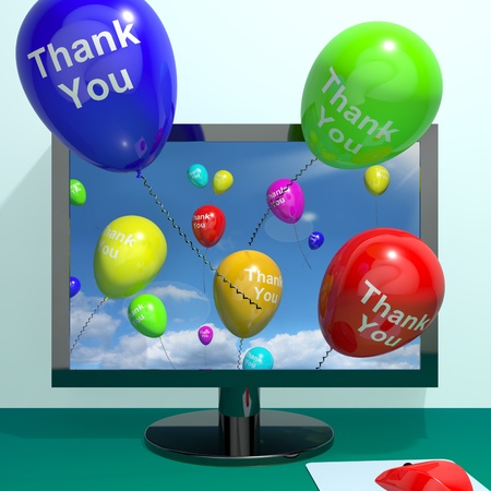 thank you: Thank You Balloons Coming From Computer As Online Thanks Messages Stock Photo