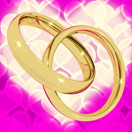 Gold Rings On Pink Heart Bokeh Background Represents Love Valentine And Romance