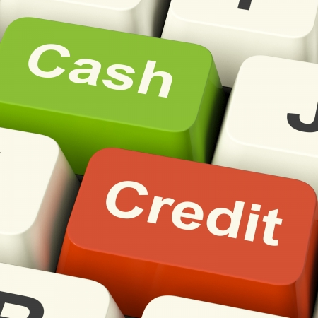 Cash And Credit Keys Showing Consumer Purchases Using Money Or Debts photo