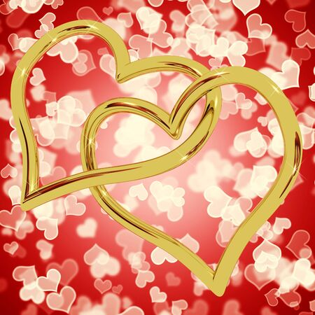 Gold Heart Shaped Rings On Red Bokeh Represents Love And Romance photo