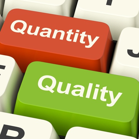 Quality And Quantity Computer Keys Showing Choice Between Excellence Or Numbers photo