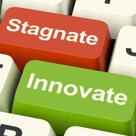 innovating: Stagnate Innovate Computer Keys Shows Choice Of Growth And Advancement Or Stagnation Stock Photo
