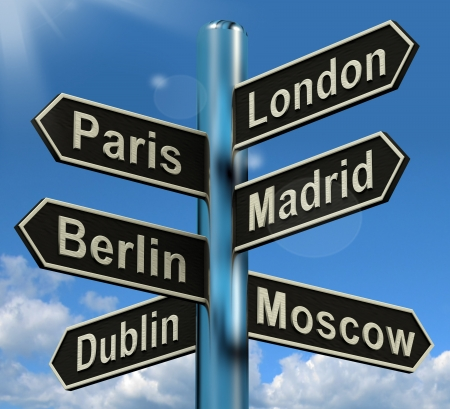 to depart: London Paris Madrid Berlin Signpost Shows Europe Travel Tourism And Destinations
