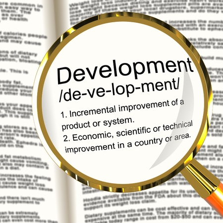 advancement: Development Definition Magnifier Shows Improvement Growth Or Advancement