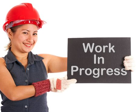Work In Progress Sign Held By A Construction Worker Stock Photo - 13988228