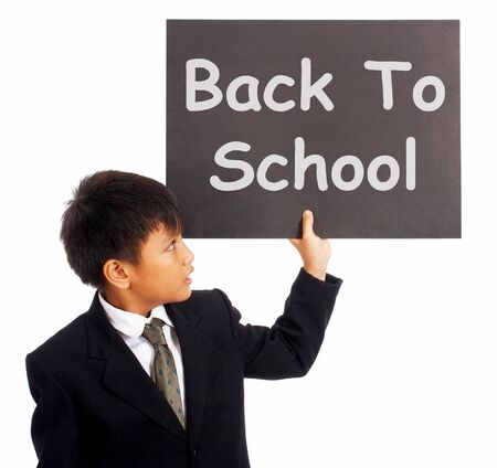 Back To School Sign With Boy As Symbol For Education And Learning photo