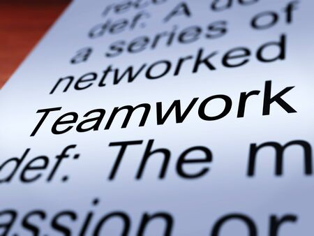 combined effort: Teamwork Definition Closeup Shows Combined Effort And Cooperation Stock Photo