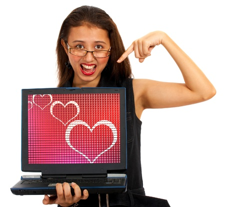 Hearts On Computer Screen Showing Love And Online Dating photo