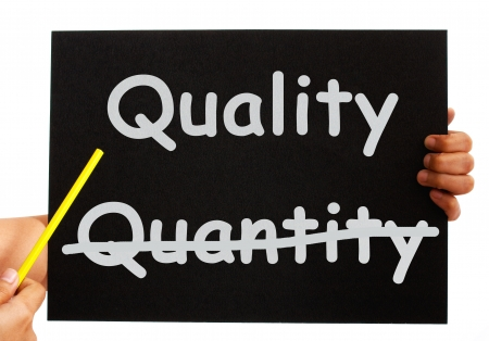 quantity: Pointing To Quality Not Quantity Words On Board Stock Photo