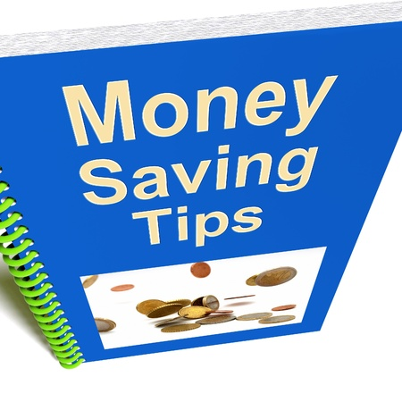 saving tips: Money Saving Tips Book Showing Finance Advice Stock Photo