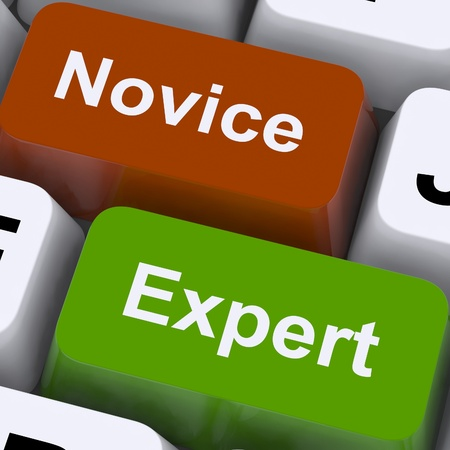 novice: Novice Expert Keys Showing Amateur Or Professional Stock Photo