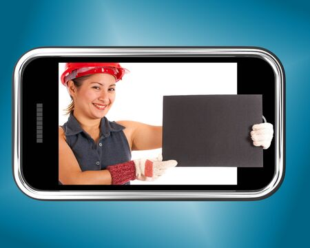 Construction Worker Holding A Blank Board On A Mobile Phone photo