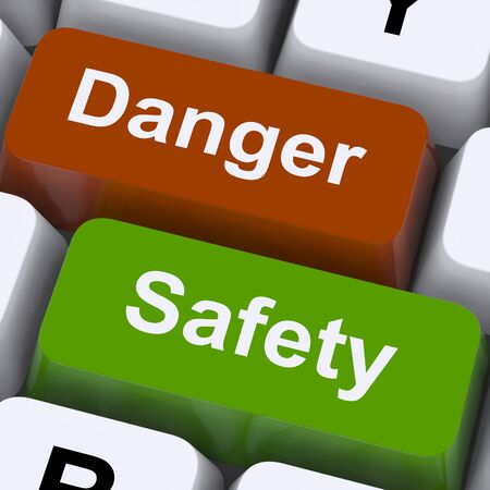Danger And Safety Keys Showing Caution And Hazards Banco de Imagens