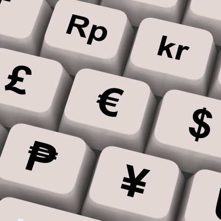 online trading: Currency Symbols On Computer Keys Showing Exchange Rates And Finance Stock Photo