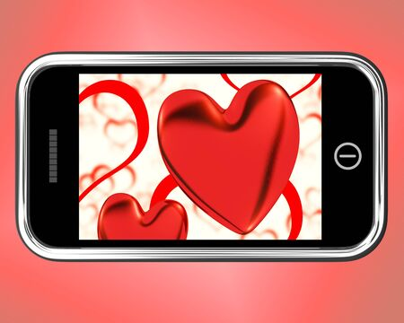 Red Hearts On Mobile Showing Love And Romance photo