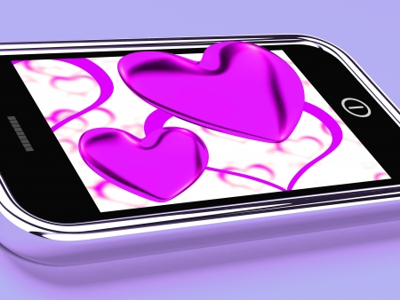 Purple Hearts On Mobile Showing Love And Romance photo