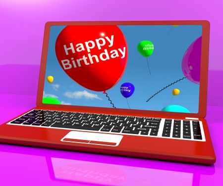 Happy Birthday Balloons On Laptop Computer Screen Shows Online Greeting Stock Photo - 15083920