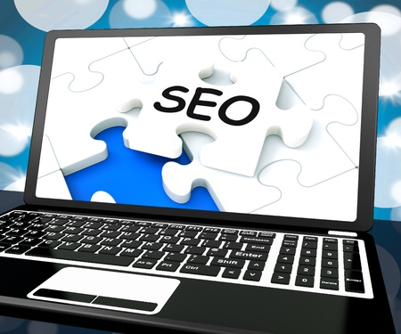SEO On Laptop Shows Search Engine Optimization And Optimized Websites Stock Photo - 16936729