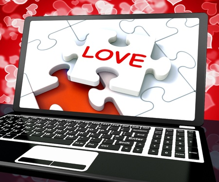 Love Puzzle On Laptop Shows Internet Dating And Virtual Couples photo