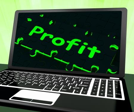 rentable: Ganancias en la computadora port�til Muestra ganancias rentables y lucrativos gana Foto de archivo