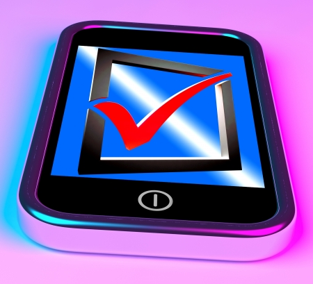 Check Mark On Smartphone Shows Checklist And Satisfaction Stock Photo - 16936658