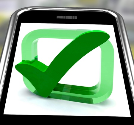 Check Mark On Smartphone Showing Approval And Satisfaction Stock Photo - 16936524