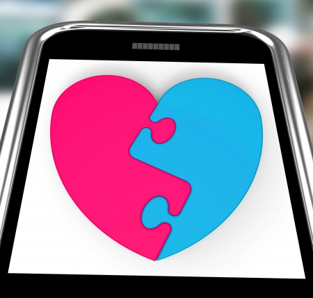 complement: Two-Pieced Heart On Smartphone Showing Complement And Love Stock Photo