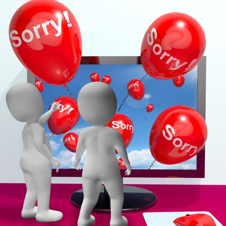 remorse: Sorry Balloons From Computer Show Online Apology Or Remorse Stock Photo