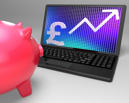 Pound Symbol On Laptop Showing Britain Increases And Growth Stock Photo - 18271390