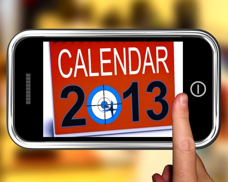 festivities: Calendar 2013 On Smartphone Showing Future Resolutions And Festivities