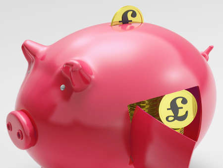Pound In Piggy Showing Currency And Investment In The UK photo