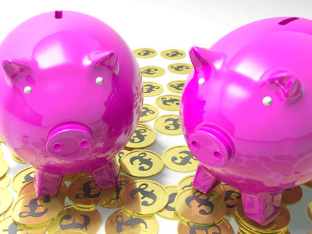 richness: Piggybanks On Pound Coins Shows Wealthy Savings Or Richness Stock Photo