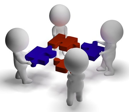 coordination: Jigsaw Pieces Being Joined Shows Teamwork And Assembling Stock Photo