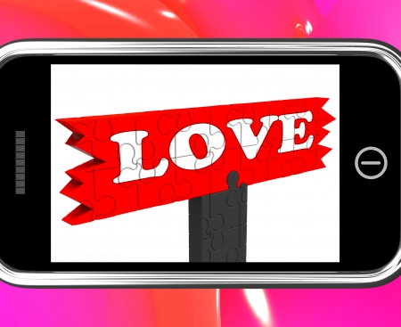 Love On Smartphone Shows Romance And Feelings photo