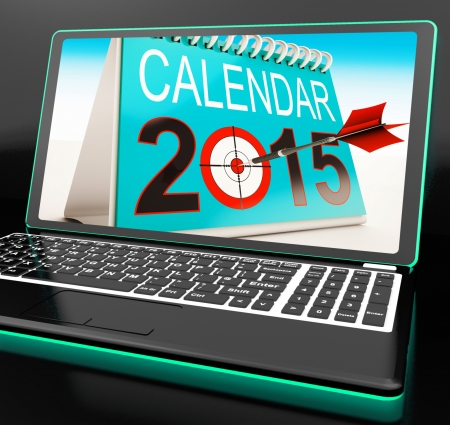 festivities: Calendar 2015 On Laptop Shows Annual Planning Or Future Festivities