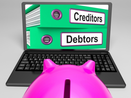 borrowing: Creditors And Debtors Files On Laptop Shows Financing Or Borrowing