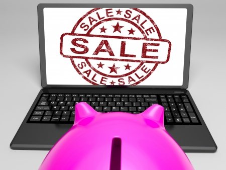 Sale Stamp On Laptop Showing Cheap Merchandise Or Promotional Prices Stock Photo - 18407864