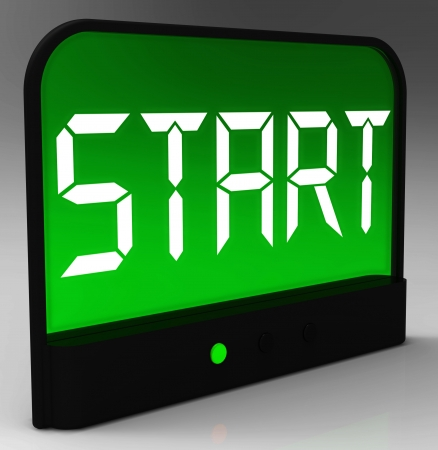 initiating: Start Button On Clock Showing Beginning Or Activating Stock Photo