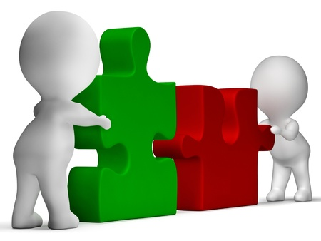 Jigsaw Pieces Being Joined Shows Teamwork And Collaboration photo