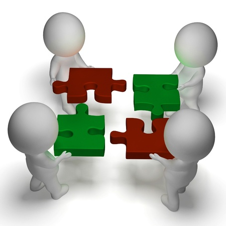 Jigsaw Pieces Being Joined Showing Teamwork And Assembling photo