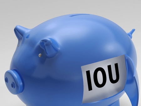 borrowing: IOU In Piggy Showing Borrowing From Savings Bank Stock Photo
