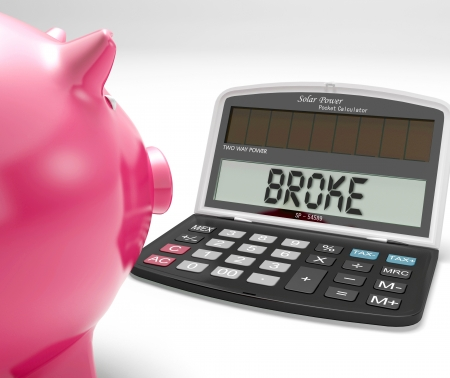 indebtedness: Piggy bank look at Broke Calculator Showing Financial Problem And Poverty Stock Photo